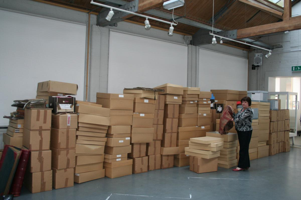 Clare Lamkin with just some of the archive in boxes in August 2010