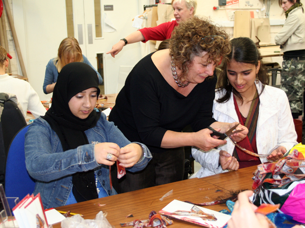 Ruth Caswell shows students how to cut the ribbons