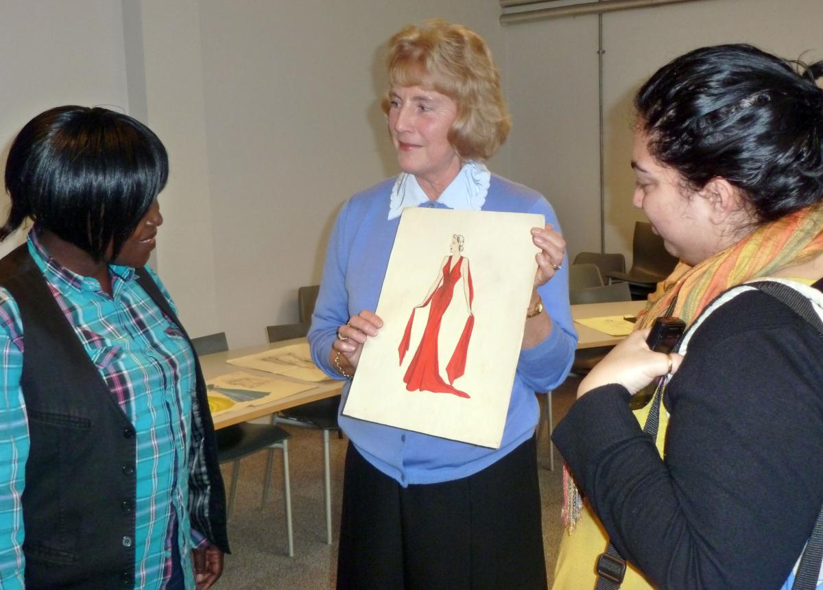 Wendy Mann shows fashion students one of her mother's designs
